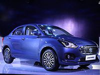 Maruti Suzuki Dzire Overview</p> <p>Unabashedly, Maruti Suzuki DZire has been the country's best-selling sedan ever since its launch around five years back in 2012. It has been clocking sales in excess of 12000 units on an average basis per month, which is way more than the combined sales of all its competitors. However, with time, the sedan started losing its charm and shine, while the sales also witnessed a gradual dip. Henceforth, in order to retain the good old days and reclaim the glory, Maruti Suzuki has brought the all-new DZire sedan with fresh styling, updated cabin and increased mileage. The sedan is offered in both petrol and diesel fuel trims in four trim levels: LXi/LDi, VXi/VDi, ZXi/ZDi and ZXi+/ZDi+. Underpinning the lightweight 'HEARTEC' architecture, borrowed from the Baleno hatch, it is available with AMT gearbox with V grade onwards in both petrol and diesel fuel trims. The new car comes packed with a plethora of advanced features, while paramount importance is given to safety with ABS, EBD, BA and dual airbags as standard across the entire variant range.</p> <p>Maruti Suzuki Dzire Exterior</p> <p>All-New Maruti DZire comes with never-seen-before exterior styling with cues borrowed from the new sibling hatch Swift, which would be launched at the grand stage of 2018 Auto Expo. It is ages ahead of the current model with front fascia reflecting an all-new hexagonal grille. Though, it is in black on the base and mid-variants, while top-end variants get chrome treatment and LED projector headlamps with daytime running lights (DRLs) as standard. The front bumper is also restyled, while the sedan rides on newly-designed precision-cut alloy wheels (limited to just Z+ trim). Predominantly, the side profile is pretty identical to the outgoing model with body colored door handles and ORVMs, save for the introduction of new alloys. Coming to the rear profile, the all-new DZire boasts of LED tail-lamp cluster and LED high mounted stop lamp. The bumper is tweaked as well to accentuate the appeal of the new sedan. </p> <p>Maruti Suzuki Dzire Engine &amp; Transmission</p> <p>All-new Maruti DZire is available in both petrol and diesel fuel trims with the same set of petrol and diesel engines. The petrol variants are powered by a 1.2L 4-cylinder K-Series engine which generates maximum power output of 82bhp at 6000rpm and peak torque performance of 113Nm at 4200rpm. On the diesel front, the company's tried-and-trusted 1.3L 4-cylinder DDiS 190 engine is at the helm of affairs. It belts out top power of 74bhp at 4000rpm and highest torque of 190Nm at 2000rpm. Both the engines are linked to a 5-speed manual transmission as standard, while the 5-speed AMT gearbox is also on offer from V trim.</p> <p>Maruti Suzuki Dzire Interior</p> <p>The interior cabin of the all-new DZire is finished in a dual-tone black and beige upholstery with faux wood and chrome inserts. As for the features, the sedan comes loaded with roof mounted antenna, front accessory socket, power steering with tilt adjustment as standard across the entire variant line-up. The base trim L is even deprived of rear power window feature, which is something we don't get to see missing often in a product worth around Rs. 6 Lakhs. Speaking of the features of V trim, the company has offered tachometer, night and day adjustable IRVM, a 2-DIN audio system with USB, CD, AUX, FM/AM, Bluetooth connectivity, 4 speakers, steering wheel mounted audio and telephonic controls as standard. Taking a leaf out of Hyundai's book, Maruti has introduced keyless entry and rear AC vents with the new DZire sedan. In addition, several premium features such as rear seat armrest with cup holders and accessory socket, central locking, electromagnetic boot opening, front and rear power windows, height adjustable driver seat, electrically adjustable ORVMs are available with the V trim. Needless to say, it looks the best variant if seen from the value-for-money proposition. Moving to the Z trim of all-new Maruti DZire, it, besides comprising of all the features of V trim, boasts of a few upmarket features in form of leather-wrapped steering wheel, reverse parking sensors, tweeters for the music system, start/stop button, and automatic climate control. The flagship Z+ trim is blessed with the touchscreen infotainment system with Navigation, Apple CarPlay and Android Auto. The touchscreen system also acts as the reverse parking camera. As one can, majority of the features introduced with the new DZire sedan were not on offer with the outgoing model. These features make the DZire premium and rich than before, while being in line with all its competitors.</p> <p>Maruti Suzuki Dzire Mileage</p> <p>All-New Maruti DZire is more fuel efficient than the preceding model due to the use of 'HEARTEC' platform as it makes the sedan lighter by 70-80 kgs than before. The petrol variants deliver a mileage of 22kmpl with both manual and AMT variants, while the diesel variants return 28.40kmpl in both manual and AMT models. Both the mileage figures are ARAI Specified. </p> <p>Maruti Suzuki Dzire Braking and Safety</p> <p>All-new Maruti Suzuki DZire gets disc brake at the front and drum brake at the rear. It can be termed as the best sedan in the segment as Maruti has paid utmost importance to the safety aspect by offering Anti-lock Braking System (ABS), Electronic Brake-force Distribution (EBD), Brake Assist (BA), dual front airbags, ISOFix Child Seat Anchorages, and Front seatbelts with pre-tensioner and load limiters as standard fitments across the entire variant range. </p> <p>Maruti Suzuki Dzire Performance and Handling</p> <p>The all-new DZire sedan comes with the same set of petrol and diesel engines but it is being learnt that the company has improved driving dynamics and performance. The handling has also seen improvement due to the inclusion of a new flat-bottomed steering wheel. The cabin noise is also quite less in the diesel variants as Maruti has worked extensively on NVH levels.</p> <p>Maruti Suzuki Dzire Competitors</p> <p>Maruti DZire challenges the likes of Honda Amaze, Hyundai Xcent, Tata Zest, Ford Aspire, Volkswagen Ameo and the recently launched Tata Tigor in the Indian market.</p> <p>What do we think about Maruti Suzuki Dzire?</p> <p>All-New Maruti DZire is priced in a range of Rs. 5.45-9.41 Lakhs (Ex. Showroom, New Delhi) in the country. The perfect amalgamation of stellar pricing and best-in-India mileage makes it the hot favorite car in the segment with a plethora of striking and advanced features on offer. The exterior styling is something out-of-the-box and the availability of AMT gearbox with almost every variant makes it one heck of a car, which could eat up even the sales of premium hatchbacks and compact SUVs.</p> <p>New Maruti Suzuki Dzire Specifications</p> <p>Specifications 	Petrol	Diesel<br /> Engine 	 1197 cc	1248 cc<br /> Max Power 	 82 bhp @ 6000 rpm	74 bhp @ 4000 rpm<br /> Peak Torque	 113 Nm @ 4200 rpm	190 Nm @ 2000 rpm<br /> Transmission	 5-speed MT/AMT	 5-speed MT/AMT<br /> The Maruti Suzuki Dzire has been the undisputed leader in the subcompact sedan space, but the segment has also gotten a lot more crowded than before. With the third generation model, Maruti has managed to iron out certain deficits while also offering a lot more now. The new Dzire competes with the new Hyundai Xcent, Volkswagen Ameo, Tata Zest and Tigor, Honda Amaze and the Ford Aspire.</p> <p>New Maruti Suzuki Dzire Dimensions</p> <p>Maruti Suzuki Dzire	Dimensions<br /> Length	3995 mm<br /> Width	1735 mm<br /> Height	1515 mm<br /> Ground Clearance	163 mm<br /> Boot Capacity	369 Litres<br /> Inside, Maruti Suzuki has made way for a plush looking cabin on the new Dzire. The car comes with leather-wrapped steering, flat-bottom steering wheel and auto climate control. The two-tone colour combination looks premium and is complemented with features like engine push start-stop button, rear AC vents and a touchscreen infotainment system that supports Android Auto and Apple CarPlay as well as MirrorLink. The new Dzire also comes with dual front airbags, ABS with EBD and Brake Assist as standard on all trims, which is welcoming. The rear seats also get ISOFIX child anchorages. The new Dzire gets the same petrol and diesel engines<br /> Under the hood, it's the same powertrain but is a lot more efficient now. The 1.2-litre K-Series 4-pot petrol is tuned for 82 bhp at 6000 rpm and 113 Nm of peak torque at 4200 rpm. The 1.3-litre DDiS diesel, on the other hand, makes 74 bhp at 4000 rpm and 190 Nm of peak torque at 2000 rpm. Both engines come paired with a 5-speed manual and Automated Manual Transmission options. The engines now return an ARAI certified fuel economy of 22 kmpl on the petrol and 28.48 kmpl on the diesel version. Both efficiency figures are the best in the segment.